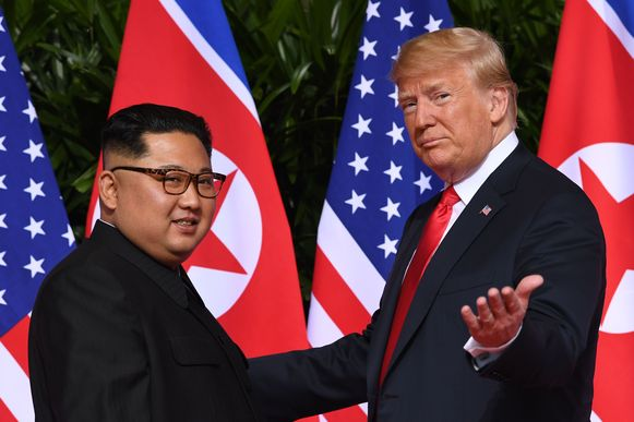 Trump en Kim Jong-un vorig jaar bij hun eerste topontmoeting.