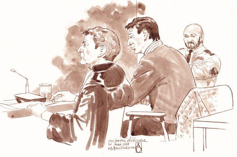 Willem Holleeder met zijn advocaat Stijn Franken tijdens een zitting in de rechtbank van Amsterdam. Beeld ANP