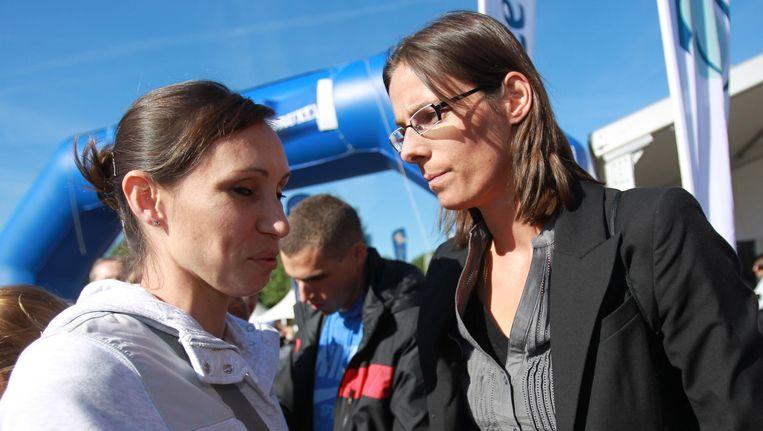 Kim Gevaert (links) en Tia Hellebaut bij de start van een vorige editie van de Acerta Brussels Ekiden.