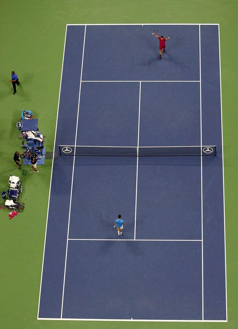 De Zwitser Stan Wawrinka viert zijn finalewinst op Novak Djokovic in de US Open. Beeld getty