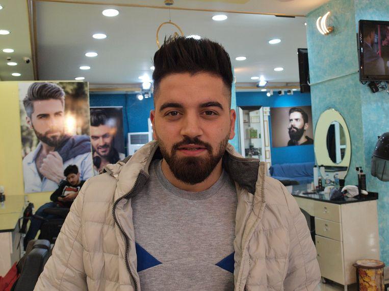 Ashraf Sherzad heeft zijn kapsel even laten bijwerken. Beeld Judit Neurink