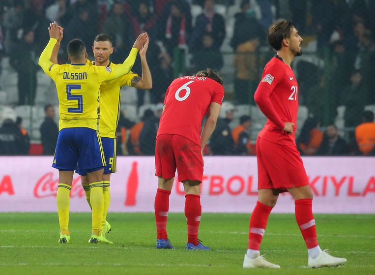 Sweden's Martin Olsson and Sweden's Marcus Berg, left, celebrate their victory after the UEFA Nations League soccer match between Turkey and Sweden in Konya, Turkey, Saturday, Nov. 17, 2018. (AP Photo)