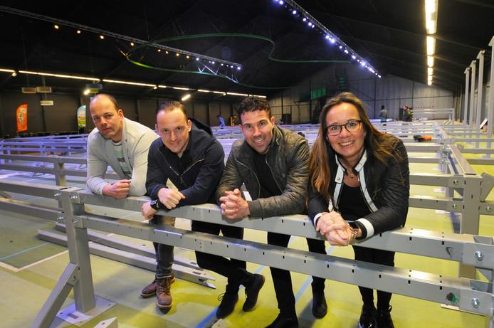 Teamleider Martijn Verdam, eigenaren Jasper van den Elsen en Pim Bruins en bedrijfsleider Agnes Rhemrev (vlnr) van Street Jump Vlissingen in de hal waar de trampolines moeten komen.