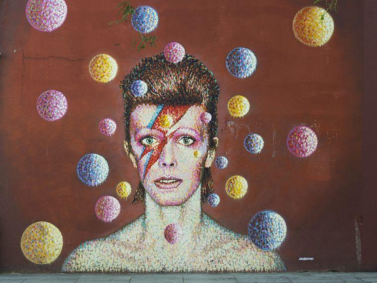 Een muurschildering van David Bowie in Londen. Beeld epa