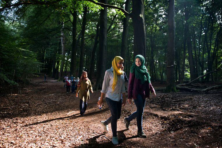 Jamilah Sherally (rechts, groene hoofddoek) van de