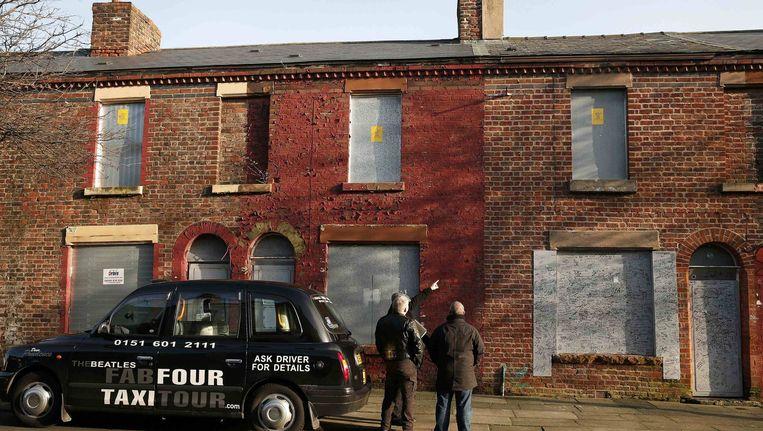 het bewuste huis in Liverpool, waar Ringo Starr zijn juegd doorbracht (op rechts). Beeld reuters