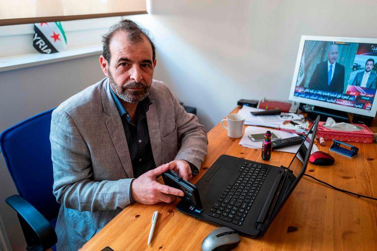 De Syrische mensenrechtenadvocaat Anwar al-Bunni in Berlijn. Beeld AFP
