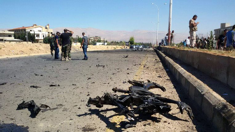 Schade na een bombardement in Sabboura, nabij Damascus.