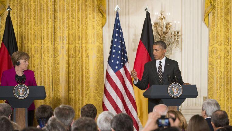 Obama tijdens een persconferentie met de Duitse bondskanselier Merkel gisteren.