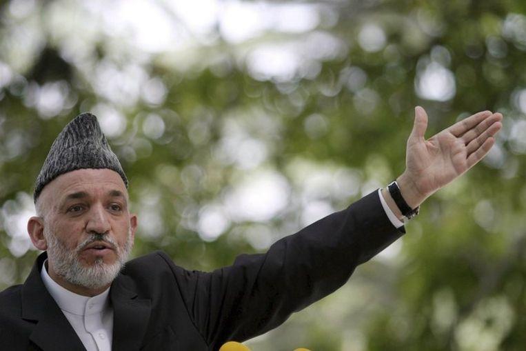 Hamid Karzai tijdens een persconferentie in Kaboel. Foto EPA/S. Sabawoon Beeld
