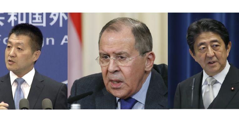 V.l.n.r: Woordvoerder van het Chinese ministerie van Buitenlandse Zaken Lu Kang, Russisch minister van Buitenlandse Zaken Sergej Lavrov en de Japanse premier Shinzo Abe