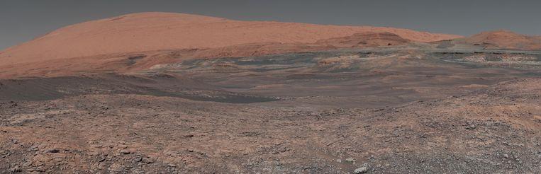 In de verlaten landschappen van Mars herken je ook een beetje de aarde. De rode planeet was ooit net zo blauw als ons thuis. Mogelijk was er zelfs ooit leven. Beeld NASA