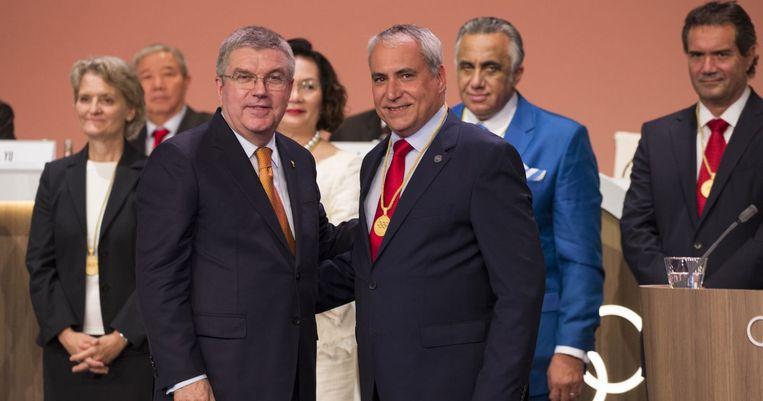 Ingmar De Vos (rechts) met IOC-voorzitter Thomas Bach.