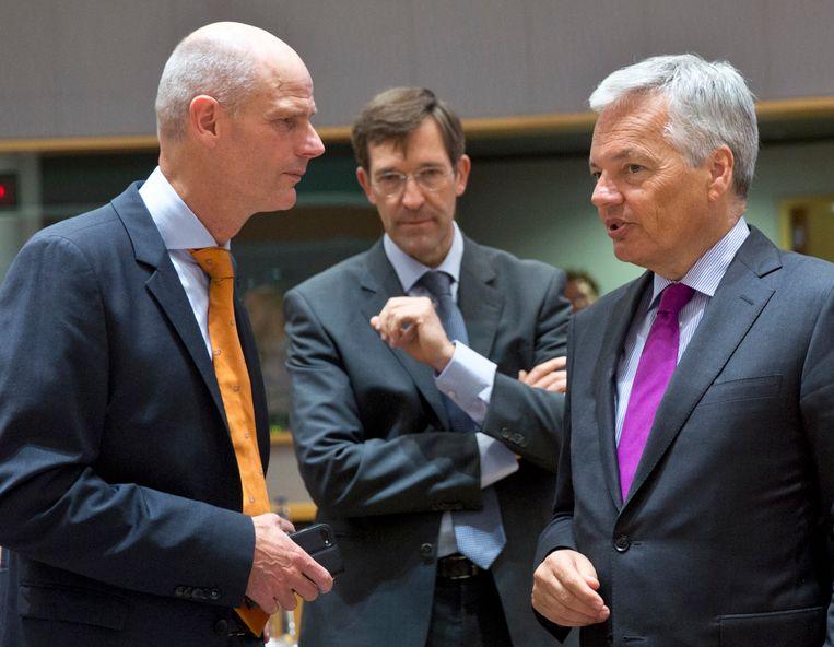 Minister Blok vandaag in Brussel in gesprek met zijn Belgische collega Didier Reynders.  Beeld AP/Virginia Mayo
