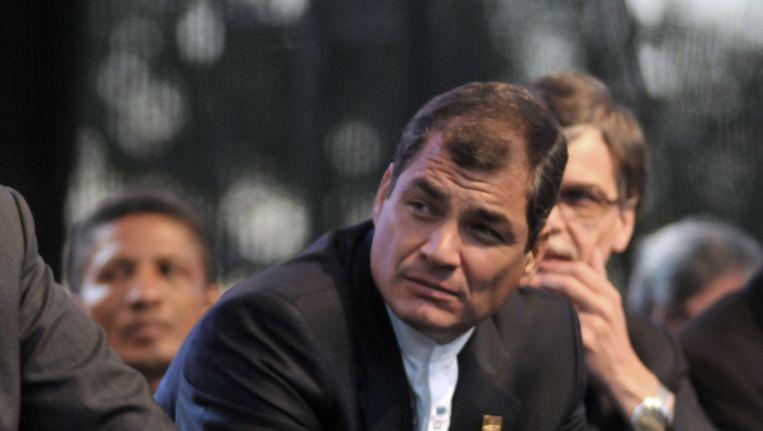 President Correa een dictator noemen kan u duur komen te staan. © ANP Beeld
