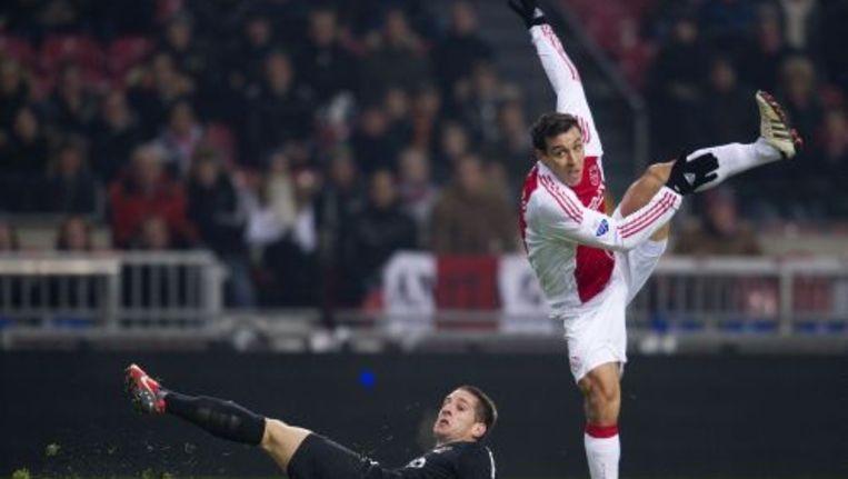 Mounir El Hamdaoui van Ajax (R) in duel met Remy Amieux (L) van NEC. Foto ANP Beeld