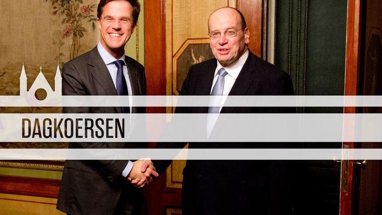 November 2012: premier Rutte feliciteert Fred Teeven die in het kabinet-Rutte II opnieuw staatssecretaris van Veiligheid en Justitie wordt. Beeld ANP/de Volkskrant