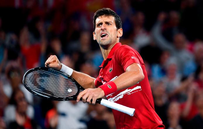 Novak Djokovic  viert zijn overwinning op Rafael Nadal.