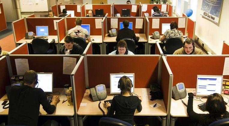 Een callcenter, pre-corona. De medewerkers en de werkplek op deze foto komen niet voor in dit interview.  Beeld ANP