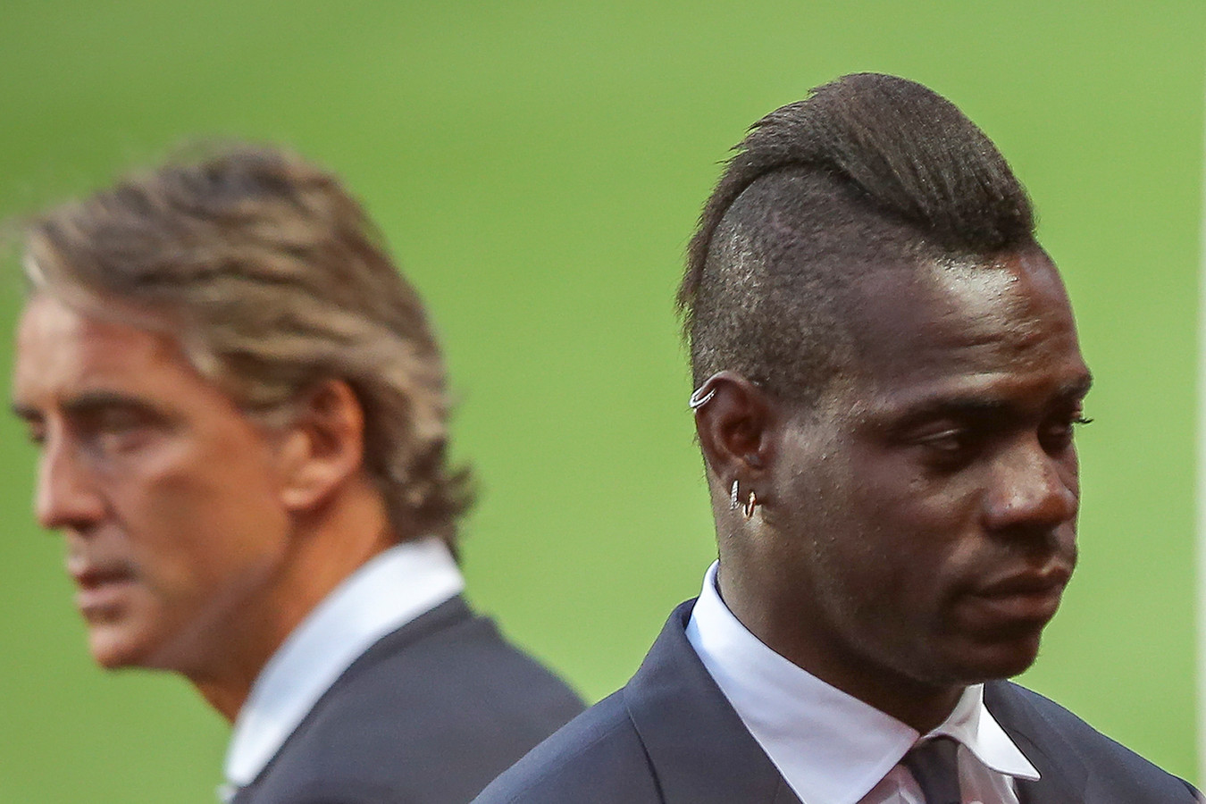 Mario Balotelli (r) en coach Roberto Mancini.
