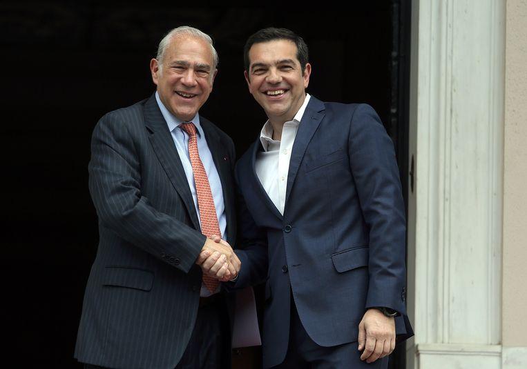 Oeso-topman Angel Gurria (L.) heeft de  Griekse premier Alexis Tsipras (R.) ontmoet.