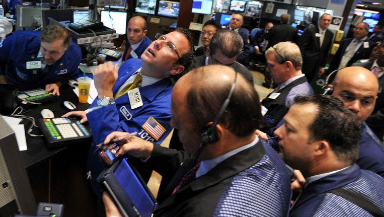 De beursvloer gisteren in New York. © AFP Beeld