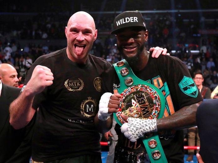 Tyson Fury en Deontay Wilder na het gevecht.