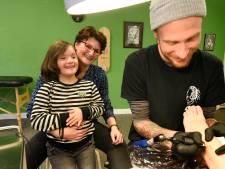 Tattoo toont trots voor kinderen met Down