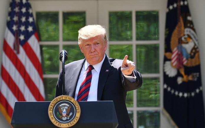 De Amerikaanse president Donald Trump tijdens zijn speech over zijn nieuwe immigratievoorstel in de Rozentuin van het Witte Huis.