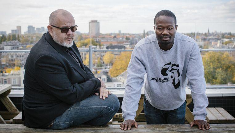 Anti-Piet-activist Jerry Afriyie (rechts) en Roelof Jan Minnebo Beeld Marc Driessen/Het Parool