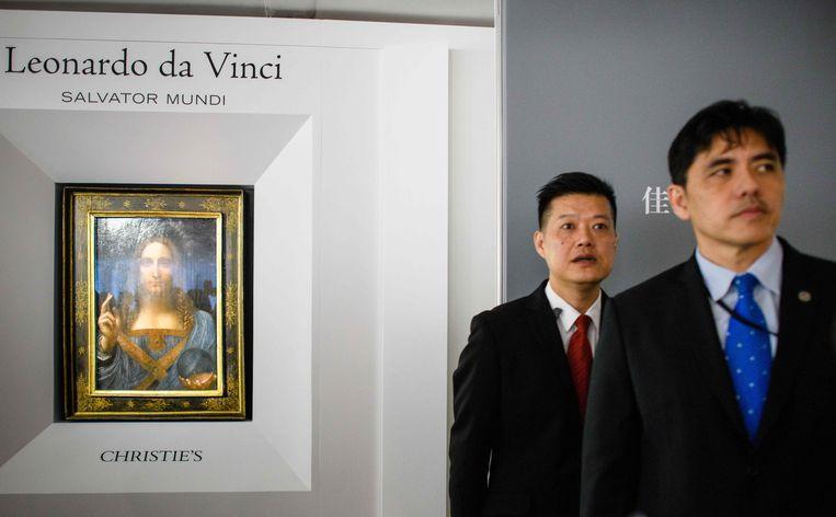 Voormalig CIA-medewerker Jerry Chun Shing Lee (l) in 2017 in Hongkong, waar hij werkte als beveiligingsfunctionaris.  Beeld AFP