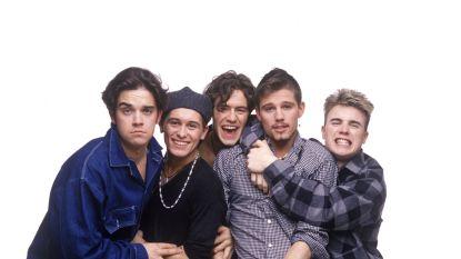 De terugkeer van Take That: van onstuimige jongensgroep tot internationaal erfgoed
