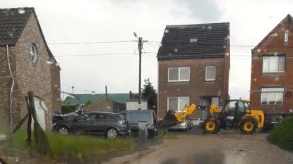 Regen valt met bakken uit de lucht in Limburg, straten onder water in Sint-Truiden, delen stad zonder stroom