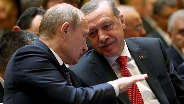 President Poetin (l) en president Erdogan (r) bij een eerdere ontmoeting Beeld epa