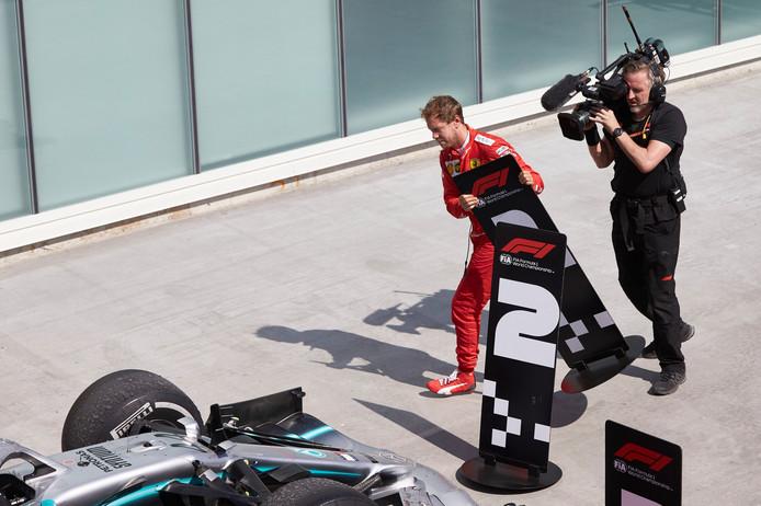 Sebastian Vettel wisselt de borden 1 en 2