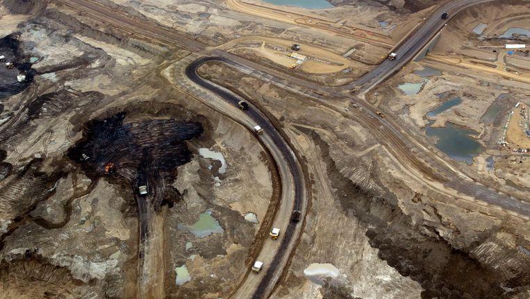Een oliewinningsproject van Shell uit teerzand bij Fort McMurray in de Canadese provincie Alberta. Teerzandolie levert nog meer broeikasgas op dan conventionele olie. Beeld getty