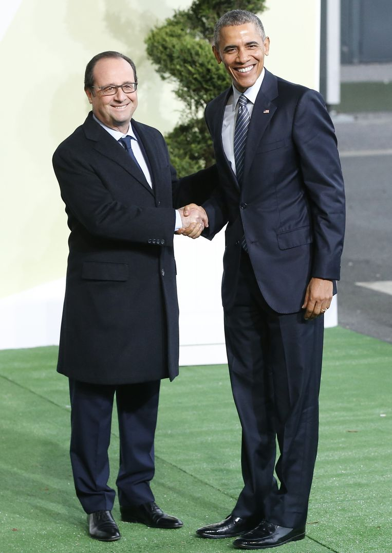 Hollande ontvangt Obama in Parijs. Beeld ap