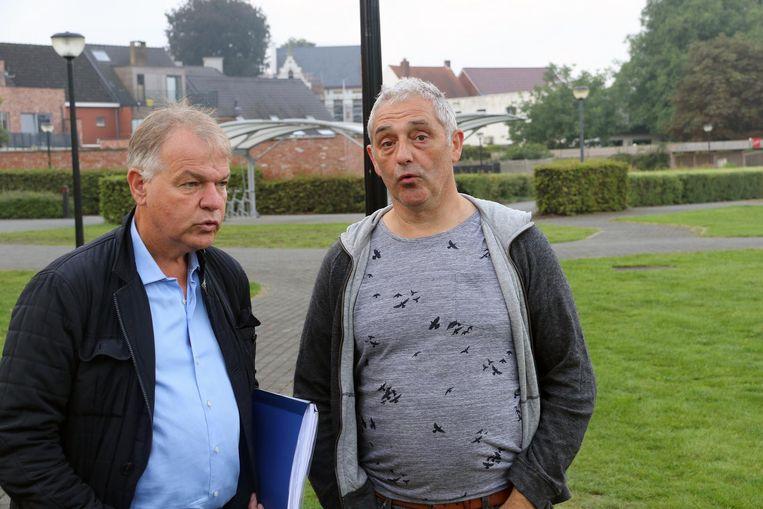 Bedrukte gezichten bij schepen Luc Janssens (l) en voorzitter Paul Wens.