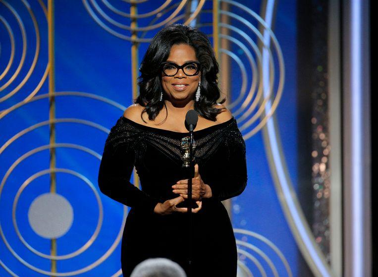 """Oprah Winfrey droeg haar prijs op aan elke vrouw die 'ik ook' durft te zeggen en elke man die durft te luisteren""""."""