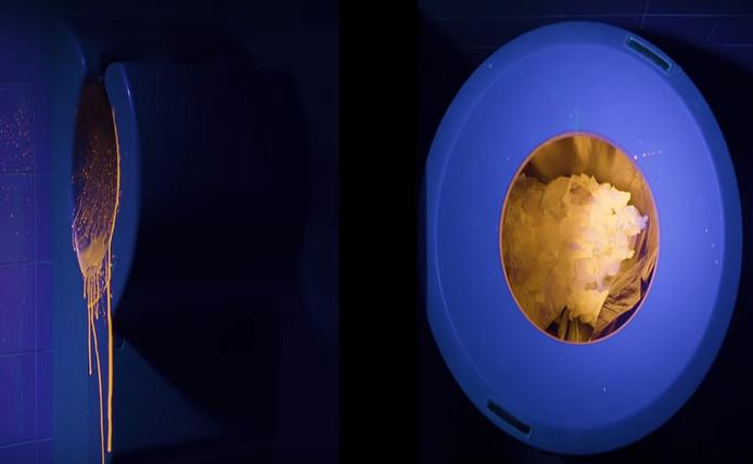 Een jetdroger en een prullenbak met papieren handdoeken. Onderzoekers hebben gekeken waar waterdruppels bij beide methoden terechtkwamen.