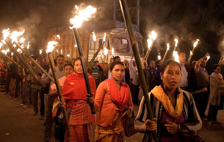 In onder meer Assam demonstreerden mensen tegen de nieuwe minderhedenwet in India. Beeld EPA