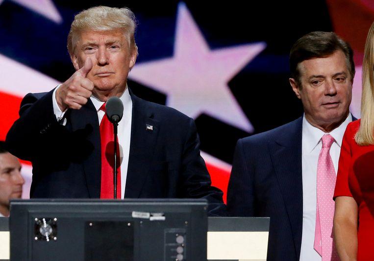Toenmalig Republikeinse presidentskandidaat Donald Trump en campagneleider  Paul Manafort bij de Republikeinse Conventie, 21 juli 2016 in Cleveland. Beeld Reuters