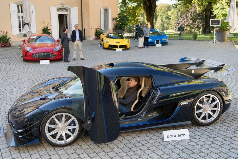 Op de voorgrond een Koenigsegg One:1.  Beeld AP