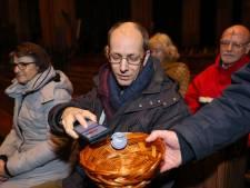 Joriskerk Eindhoven: Geen munten, toch geld in het mandje