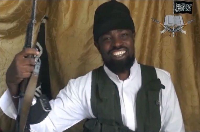 Screenshot van een video met Abubakar Shekau, de man die de leider zou zijn van Boko Haram. In de video (die in maart dit jaar werd vrijgegeven) werd er gewaarschuwd voor meer aanslagen op burgers. Beeld AFP