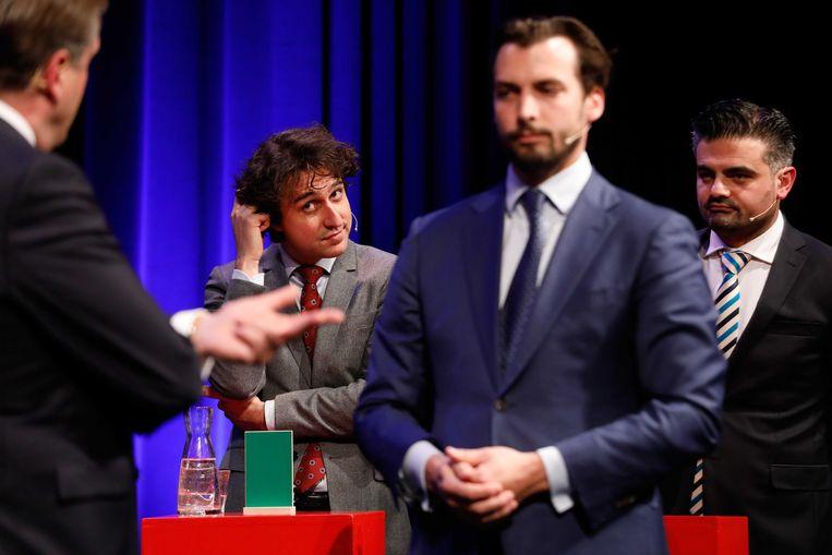 De lijsttrekkers Jesse Klaver (GroenLinks) en Tunahan Kuzu (DENK) luisteren naar Thierry Baudet (Forum voor Democratie) en Alexander Pechtold (D66) tijdens het debat in De Balie in Amsterdam. Beeld ANP