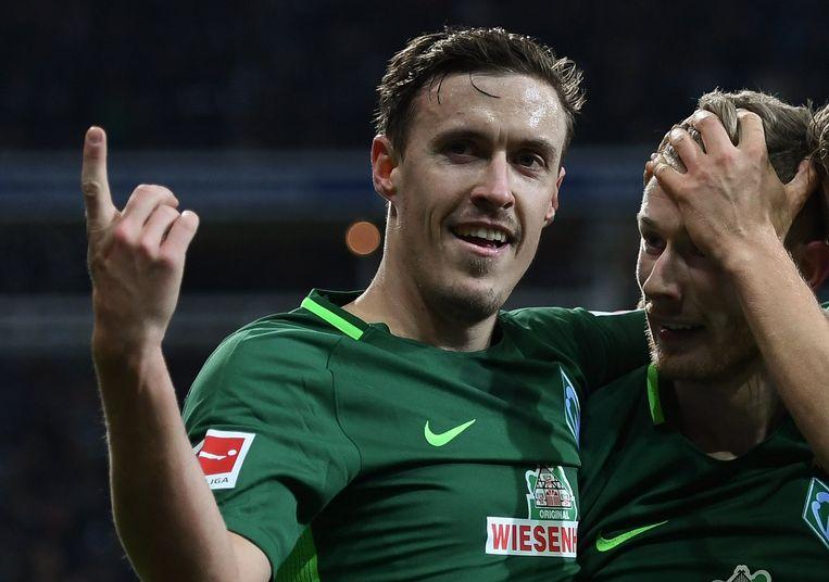 Max Kruse (L) and Florian Kainz (R) vieren na de 3-1.