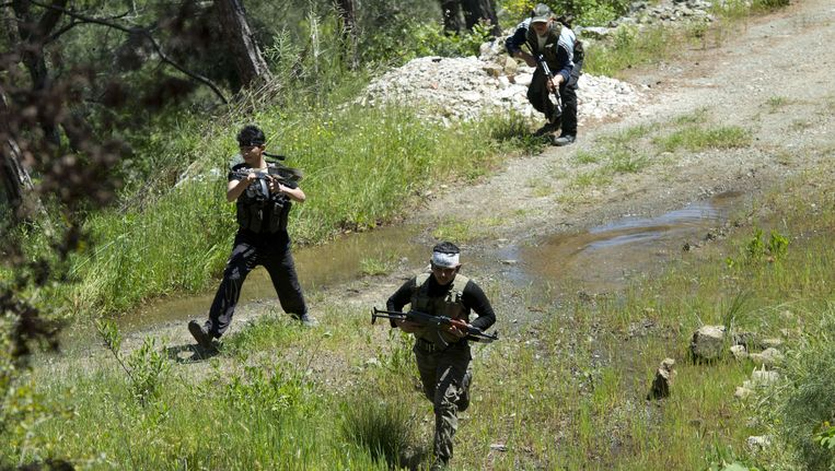 Syrische rebellen in de provincie Latakia. Beeld AFP