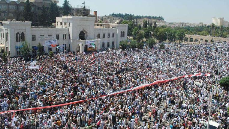 Demonstraties in de Syrische stad Hama afgelopen vrijdag. Beeld afp