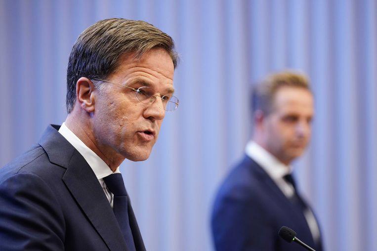 Mark Rutte en Hugo de Jonge tijdens de laatste persconferentie.  Beeld EPA